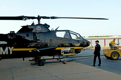 One of the Cobra Demo Team's helicopters being taken out of the hanger and brought to the flightline for the pratice flights.