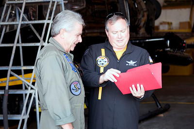 Skip Lam and Brian Calahan go over some documents prior to flight time.