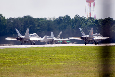 VMFA-142 planes 200 & 202 are in position for take-off while plane 209 taxis into take-off position.