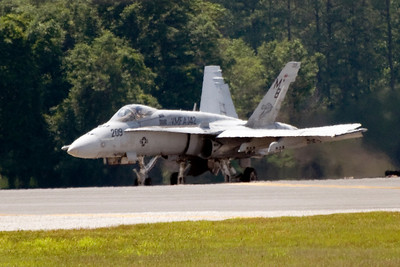 "VMFA-142 plane 209 taxis into take-off position for the last flight of the Flying Gators. Plane 209 is piloted by LtCol Jeffrey A. ""Boomer"" Baumert, who was CO of VMFA-142 from 2005-2007."