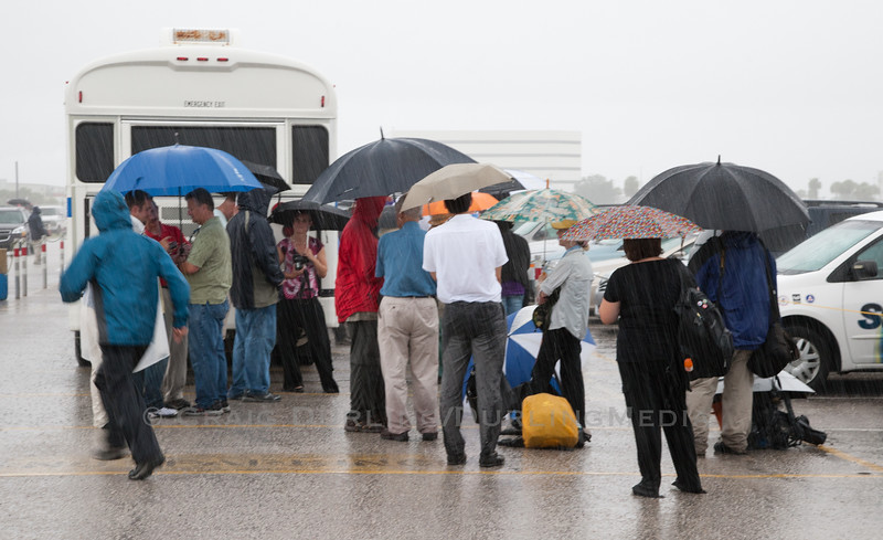 Torrential downpours did not stop the world's media from converging on Kennedy Space Center in Florida for the final launch of NASA's space shuttle program.