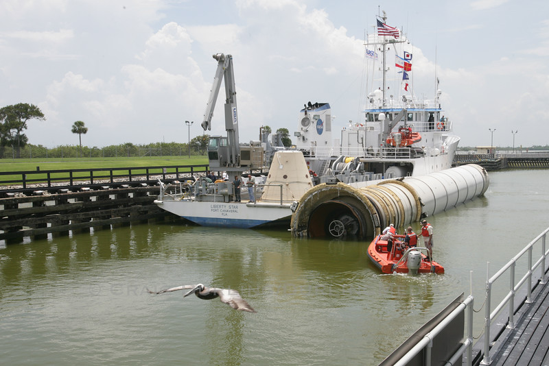 USA vessel Liberty Star tows Atlantis' right Solid Rocket Booster (SRB) into Port Canaveral after a successful retrieval from the Atlantic Ocean.