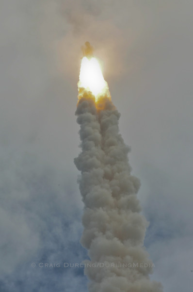 Space Shuttle Atlantis goes out of sight as it ascends into the low cloud cover which nearly kept it on the ground.  Atlantis successfully left the earth for the final time, bringing an end to an historic space shuttle program.