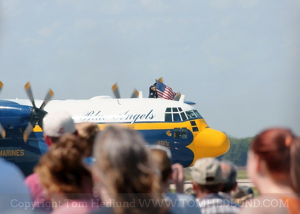 The Blue Angels C-130 know as Fat Albert displaying the American flag after their flight demostration