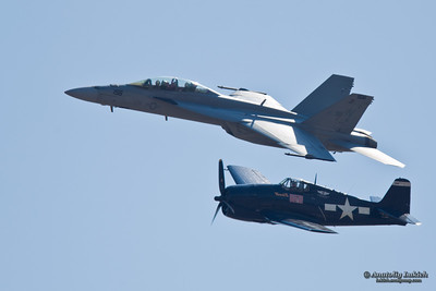SACRAMENTO, CA - SEPT 10: Grumman F6F Hellcat World War II aircraft and Boeing F/A-18 Super Hornet aircraft during heritage flight at the California Capital Airshow, on September 10, 2011 at Mather Airport, Sacramento, CA.