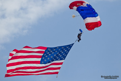SACRAMENTO, CA - SEPT 10: Unidentified participant of California Capital Airshow dives from an airplane with the United States flag attached to his parachute on September 10, 2011 at Mather Airport, Sacramento, CA.