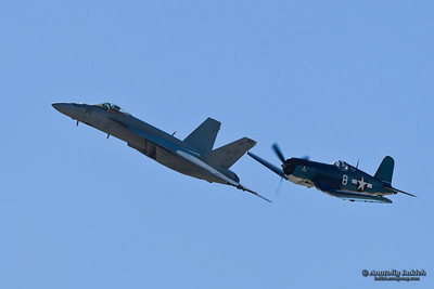 SALINAS, CA - SEPT 25: US NAVY Boeing F/A-18 Super Hornet and Vought F4U Corsair during heritage flight at the California International Airshow, on September 25, 2011, Salinas, CA.
