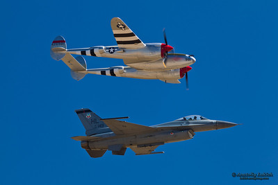 SACRAMENTO, CA - SEPT 8: Lockheed P-38 Lightning WW II and modern F-16C Fighting Falcon aircrafts perform heritage flight at the California Capital Airshow on September 8, 2012 at Mather Airport, Sacramento, CA.