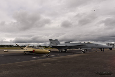 OLYMPIA, WA - JUNE 17: Fouga CM.170 Magister and VFA-122 Boeing F/A-18E Super Hornet aircraft parked during Olympic Air Show at Olympia Airport on June 17, 2012 in Olympia, WA.