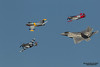 HILLSBORO, OR - SEPT 21: P-51 Mustang World War II, North American F-86F Sabre and modern USAF F-22 Raptor aircrafts perform heritage flight during Oregon International Air Show at Hillsboro Airport on September 21, 2014 in Hillsboro, OR.