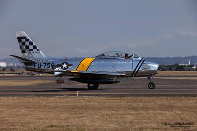 HILLSBORO, OR - SEPT 21: North American F-86F Sabre demonstration during Oregon International Air Show at Hillsboro Airport on September 21, 2014 in Hillsboro, OR.