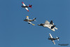 HILLSBORO, OR - SEPT 20: P-51 Mustang World War II, North American F-86F Sabre and modern USAF F-22 Raptor aircrafts perform heritage flight during Oregon International Air Show at Hillsboro Airport on September 20, 2014 in Hillsboro, OR.