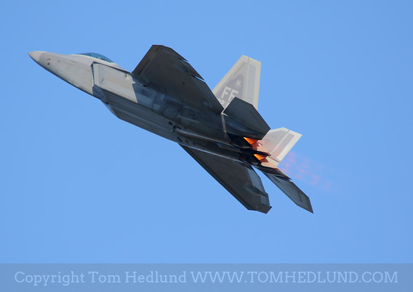 The U.S Air Force's F-22 using a little burner to kick off its demonstration.