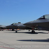 A few fifth generation fighters on the ramp at Scotts AFB.