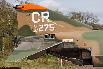 "Tail close-up. This Phantom never flew for the 32nd FG at Soesterberg Air Base (Camp New Amsterdam), but it is now painted in the c/s of the 32nd FG ""Wolfhounds"". The 32nd FG ""Wolfhounds"" was based at Soesterberg from 1954 till 1994. This aircraft is in fact F-4E Phantom II (reg: 67-0275, cn3011), which flew for the 35th TFS, 3rd TFW at George AFB, Ca. It was credited with a MiG kill on September 12, 1972 (at that time piloted by Lt.Col.Lyle L. Beckers and 1Lt Thomas M. Griffin)."