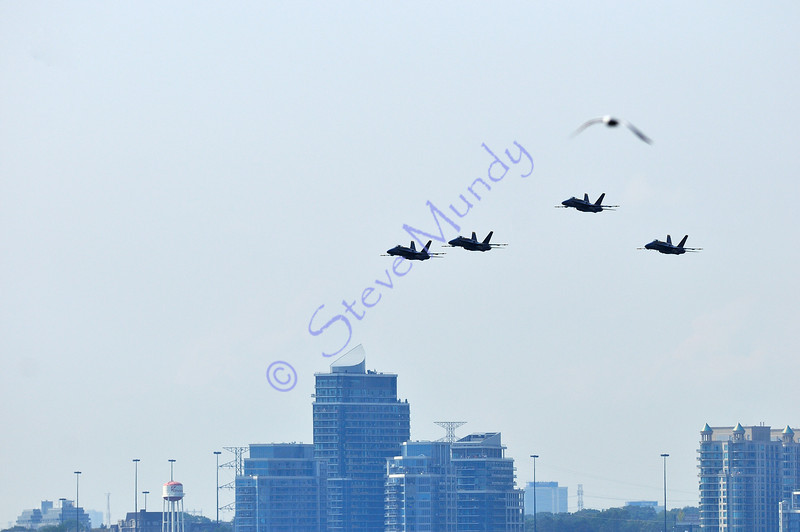 Flying in formation ... 5 Blue Angels ... hey ... where'd number 5 come from????