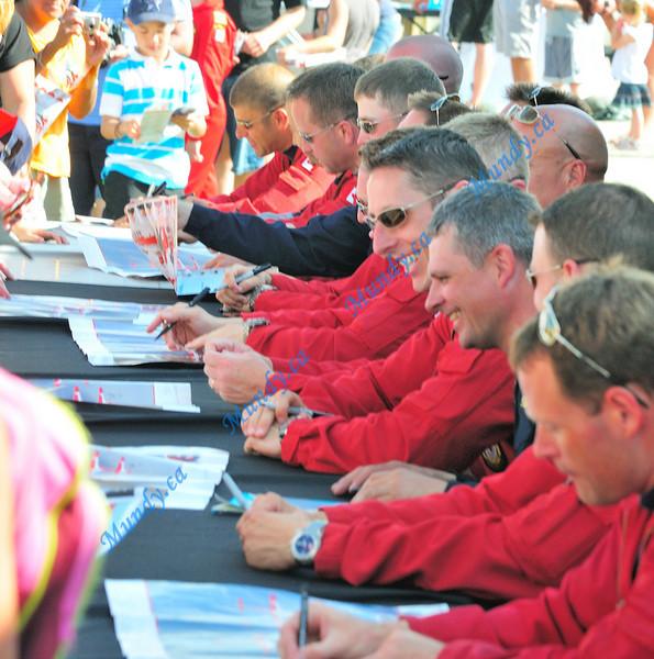 Signing autographs ...