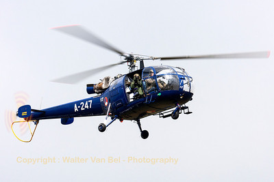 "The crew of this Royal Netherlands Air Force SA-316B Alouette III (A-247, cn1247) was taking pictures of the spotters and spectators during the ""Luchtmachtdagen 2013"" at Volkel Air Base. Shall we exchange photographs?"