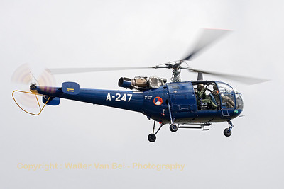"The crew of this Royal Netherlands Air Force SA-316B Alouette III (A-247, cn1247) was taking pictures of the spotters and spectators during the ""Luchtmachtdagen 2013"" at Volkel Air Base."