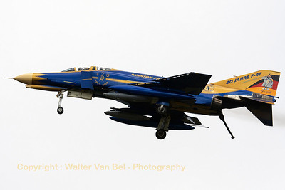 "JG71's celebration F-4F Phantom II (37+01, cn4330) is seen here arriving at Volkel, performing a low fly-by with the tail-hook lowered. This Phantom wears the special c/s for ""40 years F-4F Phantom II operations within the German Air Force"".  It also wears a special stamp around its registration ""First in Last out"" and Spooky states ""Ich melde mich ab"" on the colorful tail."