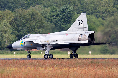 "This ""natural metal"" AJS-37 Viggen (52-7, ""SE-DXN"", cn37098), slowing down on Volkel's runway by using its thrust reversers. Look how the thrust reversers completely block the rear exhaust and bend the thrust into a forward direction! (Luchtmachtdagen 2013)."