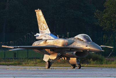 """ZEUS"", the Greek Air Force solo demo on F-16C (505; cnXK-6) form 343 Mira, is seen here turing onto RWY05L at KB - with the very last rays of sun - for its late evening practise during the spottersday, prior to the Belgian Air Force days 2014."