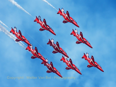 The RAF Red Arrows (XX244; cn080/312080) completing their diamond-9 formation loop, during their opening display at Southport Airshow 2014. The Red Arrows wear their special anniversary paint scheme for the team's 50th display year.
