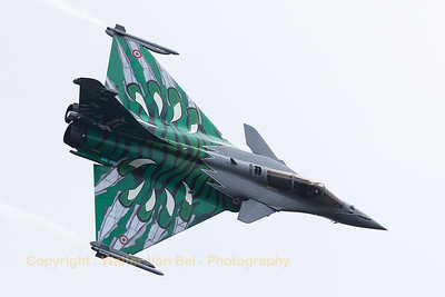 """French Air Force Rafale C (113-IX; cn119),  with splendid """"Green Monster"""" Tiger c/s created for the 2015 NATO Tiger Meet, in action above Leopoldsburg during the 2015 Sanicole Air Show."""