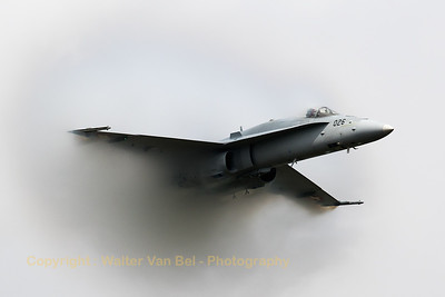 "The Swiss Air Force demo pilot Captain Julien Meister, aka ""Teddy"", creates a huge vapour cloud when his F/A-18C Hornet (J-5026; cn1375/SFC026) thunders through the very humid air at Florennes Air Base during the spottersday, prior to the Belgian Air Force Days 2016."