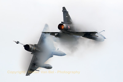 """Ramex Delta"", the French Air Force demo team with their Mirage 2000N's (375; 125-CL) from EC2/4, break hard on arrival at Florennes Air Base and almost dissapear in their own-generated vapour cloud, due to the very humid conditions during the spottersday, prior to the Belgian Air Force days."