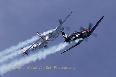 "The ""Red Bull"" Vought F4U-4 Corsair (RB-37; cn9149; ex BuAerNo.96995) flies in close formation with the Lockheed P-38 Lightning (N25Y/13; cn422-8509) during ""Airpower16"" at Zeltweg Air Base."