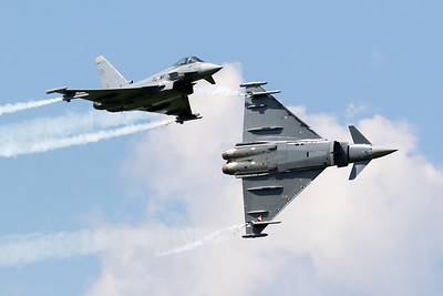 "Two Austrian Air Force Typhoons (7L-WF; cn148/AS006 and 7L-WI; cn139/GS028) perform a break, prior to their solo display during ""Airpower 16"" at Zeltweg Air Base."
