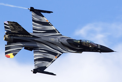 "The ""Dark Falcon"" F-16AM (FA-101; cn6H-101), piloted by Stefan ""Vador"" Darte, showing the top-side while performing a knife-edge pass during the Athens Flying Week at Tanagra Air Base."