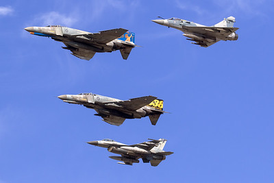 "An Hellenic Air Force F-4E AUP Phantom II (71744; cn4998), still wearing the special c/s for the ""Celebration of 65 years operations by AIAS"", leads a mixed formation (F-16C, another F-4E and a Mirage 2000EG) during the Athens Flying Week at Tanagra AFB (2018)."