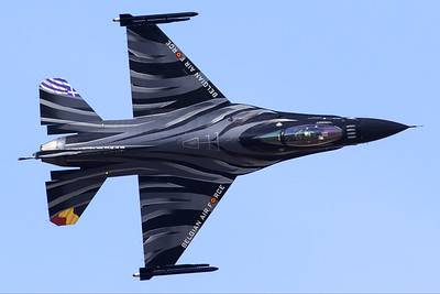 "The ""Dark Falcon"" F-16AM (FA-101; cn6H-101), piloted by Stefan ""Vador"" Darte, showing the top-side while performing a knife)edge pass during the Athens Flying Week at Tanagra Air Base."