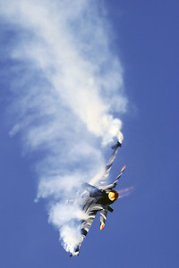 """The """"Dark Falcon"""" F-16AM (FA-101; cn6H-101), piloted by Stefan """"Vador"""" Darte, is painting the sky during her magnificient performance at the """"Luchtmachtdagen 2019"""" at Volkel AFB."""