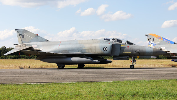 """Hellenic Air Force F-4E AUP Phantom II (71758; cn5037) from 338 Sqn, in the static during the """"Luchtmachtdagen 2019"""" at Volkel, next to her colourful stablemate (01507; cn4465) with a special c/s to celebrate their visit to """"Pholkel""""."""