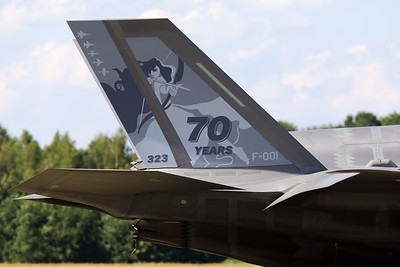"""Tail close-up of a Royal Netherlands Air Force F-35A Lightning II (F-001; cnAN-1) in the static during her second appearance at an airshow in the Netherlands, now with a special c/s to celebrate """"70 years of 323 Sqn"""" (""""Luchtmachtdagen 2019"""" at Volkel AFB)."""