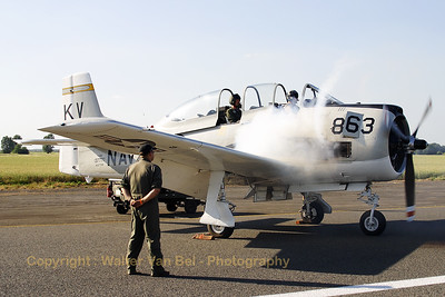 It's always nice to watch the start-up of a warbird! This T-28B Trojan produces a puff of white smoke while the engine is being started. Beauvechain Air Show 2010.