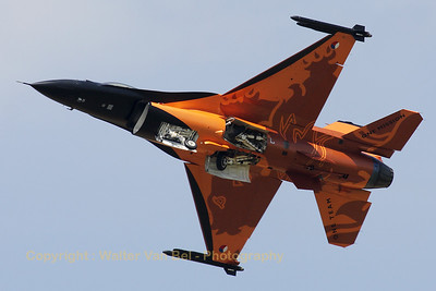 "The new RNLAF demo pilot Capt. Tobias ""Hitec"" Schutte shows the bottom side of his ""Orange Lion"" while retracting the landing gear."