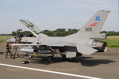 This Norwegian Air Force F-16BM had just arrived and ground crew assist the pilot. Note that the travel pod was already opened by the ground crew, making it easy for the pilot to get to his belongings. Beauvechain Air Show 2010 (arrival days).