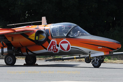 """The new """"Tiger"""" c/s applied on this Austrian Air Force Saab 105OE looks beautiful! It is seen here parked at the flight-line after a rehearsal for the Beauvechain Air Show 2010."""