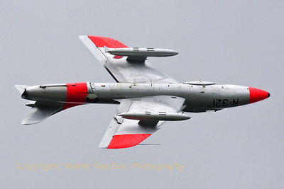 The Dutch Hawker Hunter Foundation's Hunter T8C (G-BWGL/N-321;cn:41H/695946) performs a slow roll during its practise dispaly, on the arrival day for the Florennes 2012 Airshow.