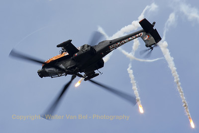 The 2010 Apache Solo Display is popping flares while rolling inverted during the 2010 Air Show at its home-base (Luchtmachtdagen 2010 at Gilze-Rijen).