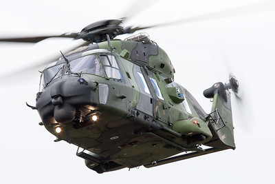 Impressive display - despite the harsh weather - by this Finish Army NH-90 (NH-202; cn1011) [Luchtmachtdagen 2010].