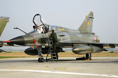 A French Air Force Mirage 2000N (309; 4-AO), in the static at Koksijde, undergoing some very specific inspection,  during the 2005 Air Show.
