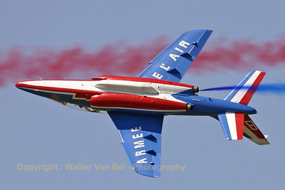 "E31 / F-TERK/8 (cn E31) Patrouille de France Alpha-Jet ""8"" showing its belly during a roll. The piping of the smoke-system is clearly visible."