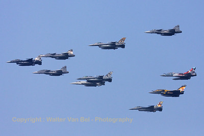 Mass formation fly-by of some of the 2009 Nato Tiger Meet participants with special c/s, during the Sanicole Air Show. The KB-Tiger (FA-87; cn6H-87) of 31-squadron is leading the flock.