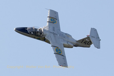 A Saab 105 Sk60A  - a classic Saab jet operated and displayed by the Swedish Air Force Historic Flight - in action in the skies above Leopoldsburg (EBLE) during the 2012 Sanicole Airshow.