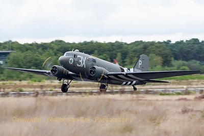 "This C-47A Skytrain (DC-3) ""Drag Em Oot"" is seen here completing its landing roll at KB, after a local flight during the spottersday, prior to the Sanicole Airshow 2013."